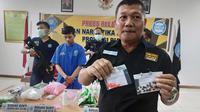 Tablet obat berisi serpihan pil ekstasi yang dihancurkan oleh kaki tangan bandar narkoba di Pekanbaru. (Liputan6.com/M Syukur)