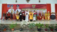 Kelurahan Tebing Tinggi di Kecamatan Tebing Tinggi, Kabupaten Tanjung Jabung Barat, Jambi dijadikan Kampung Pancasila karena warganya yang multietnis selalu menjaga kerukunan dan kedamaian. (B Santoso/Liputan6.com)