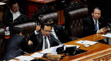 Hasil voting sidang Paripurna RUU Pilkada memutuskan Pilkada dipilih oleh DPRD, Jakarta, (26/9/14). (Liputan6.com/Andrian M Tunay)