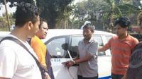 Salah satu pelaku saat ditangkap polisi. (Liputan6.com/ Yandhi Deslatama)