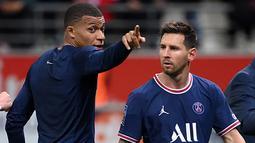 Pada laga debutnya, Messi mengiringi PSG meraih kemenangan 2-0 atas Reims pada duel di Stadion Stade Auguste-Delaune II. Dua gol PSG diborong Kylian Mbappe pada menit ke-16 dan 63. Messi tidak mencetak gol. (Foto: AFP/Franck Fife)