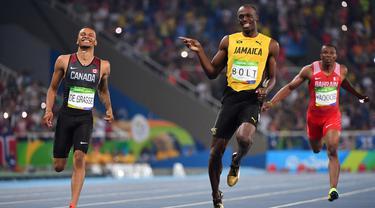 Andre De Grasse (kiri) merupakan peraih medali perak nomor 200 meter dan medali perunggu nomor 100 meter serta nomor 4x100 meter pada Olimpiade Rio 2016 lalu. Dengan pensiunnya Bolt (tengah), dirinya diprediksi akan sabet medali emas pada Olimpiade Tokyo 2020 ini. (Foto: AFP/Olivier Morin)