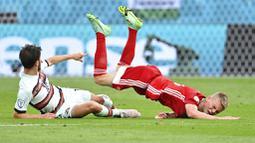 Penampilan disiplin Hungaria benar-benar membuat sang juara bertahan Portugal kesulitan menembus lini pertahanan lawan. (Tibor Illyes/Pool via AP)