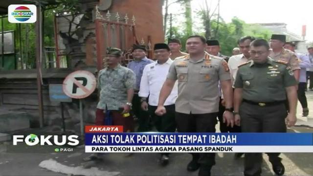Tokoh lintas agama Jakarta Barat gelar aksi bentang spanduk tolak kampanye di tempat ibadah.
