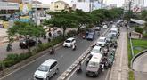 Kendaraan melintasi Jalan Margonda Raya, Depok, Jawa Barat, Kamis (21/3). Badan Pengelola Transportasi Jabodetabek (BPTJ) bersama Dishub Kota Depok akan memberlakukan aturan ganjil genap di Jalan Margonda Raya. (Liputan6.com/Immanuel Antonius)