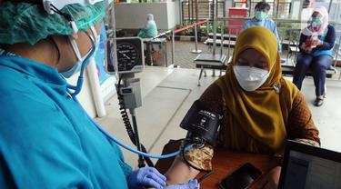 FOTO: Puskesmas di Jakarta Mulai Lakukan Vaksinasi Virus Corona COVID-19