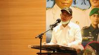 Menko PMK Muhadjir Effendy mengapresiasi kerja keras pemerintah Kabupaten Merauke dalam menanggulangi penyebaran COVID-19 dalam rapat koordinasi Wakil Bupati Merauke, Ketua DPRD Merauke, Pangdam Cendrawasih, Danlantamal Merauke, Rabu (8/7/2020). (Dok Badan Nasional Penanggulangan Bencana/BNPB)