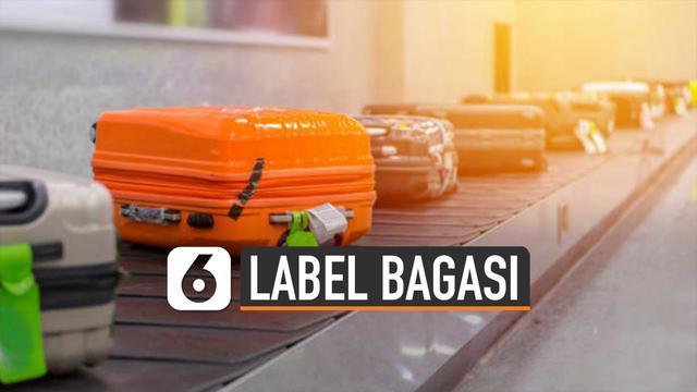 Label bagasi berfungsi amankan tas atau koper untuk bisa kembali kepada pemiliknya saat keluar dari pesawat.