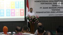 Mendes PDTT Eko Putro Sandjojo memberi sambutan dalam penandatanganan kerja sama Kemendes PDTT dengan Bank Mandiri di Kantor Kemendes PDTT, Jakarta, Senin (30/9/2019). Bank Mandiri mendukung Kemendes PDTT melalui layanan produk dan jasa perbankan. (Liputan6.com/Angga Yuniar)