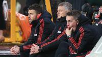 Manajer Manchester United, Ole Gunnar Solskjaer saat anak asuhnya bersua Wolverhampton Wanderers, Minggu (17/3/2019) dini hari WIB. Manchester United takluk 2-3.  (AFP / Lindsey Parnaby)
