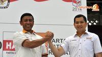 Wiranto dan Hary Tanoesoedibjo melakukan salam komando sebagai salah satu bukti optimis mendekati Pemilu 9 April mendatang (Liputan6.com/Panji Diksana)