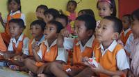 Anak-anak di TK Tambak Sari Terlibat Aktif dalam Program Peningkatan Kesehatan GIzi dan Mulut