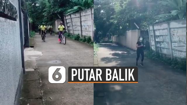 Rombongan pesepeda dan seorang yang jogging itu akhirnya putar balik setelah tak menghiraukan peringatan dari perekam video.