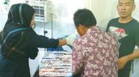 Korban suami bacok istri dirawat intensif di Rumah Sakit Bhayangkara Polda Riau. (Liputan6.com/M Syukur)