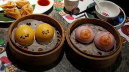 Berbagai hidangan dengan hiasan imut dan lucu di restoran Dim Sum Icon, Hong Kong , China, (25). Berbagai sajian makanan disini dihiasi dengan karakter wajah dan imut yang membuat kita tak tega memakannya. (REUTERS / Bobby Yip)