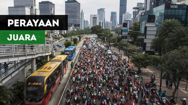 Berita video perayaan Persija Jakarta menjadi juara Piala Presiden 2018 bersama Jakmania di jalanan dan balai kota pada Minggu (18/2/2018).