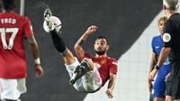 Dalam 25 penampilan Premier League sejauh ini, Bruno Fernandes telah mencetak 15 gol luar biasa dan 10 assist. (Foto: AFP/Pool/Michael Regan)