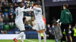 Kiper asal Spanyol itu baru masuk bermain di menit ke-119 menggantikan Edouard Mendy yang sebenarnya bermain baik. (Foto: AFP/Paul Ellis)