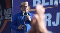 Mantan Menteri Perdagangan Rachmat Gobel memberikan sambutan saat menghadiri Kampanye Rapat Umum di Gorontalo, Minggu (24/3). Partai Nasdem mengawali Kampanye Terbuka di Provinsi Gorontalo. (Liputan6.com/Arfandi Ibrahim)