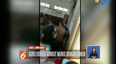 Seorang guru di Garut dilaporkan wali murid karena diduga telah menghukum murid dengan menyundutkan rokok, lantaran sang murid tidak mengerjakan PR dan belum bisa berhitung.
