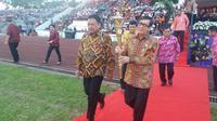 Menkum HAM Yasonna Laoly  dan Gubernur Sulut, Olly Dondokambey, menghadiri acara Ibadah Agung Perayaan Paskah Nasional  (Liputan6.com/Istimewa)