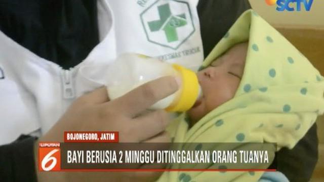 Bayi berusia sekitar 2 mingguan ini ditinggal di kursi sebuah warung dengan sekotak susu formula.