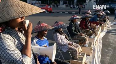 Petani menegaskan, aksi pasung kaki ini tak akan selesai hingga Presiden mengabulkan tuntutan para petani.