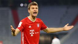 Thomas Muller adalah pemain yang telah mendapatkan banyak trofi ketika bermain di Bayern Munich maupun di Timnas Jerman. Ia menyabet treble winner musim 2012/2013 dan Piala Dunia pada 2014. Namun ia hanya mampu berada di posisi lima besar pada ajang Ballon d'Or. (Foto: AFP/Pool/Kai Pfaffenbach)