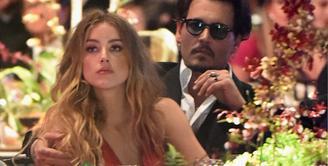 Proses cerai Johnny Depp dan Amber Heard telah mencapai titik akhir. Sebagai juru bicara dan tim kuasa dari pihak Depp, seorang pengacara wanita Laura Wasser memberikan kabar terbaru soal perceraiannya ini. (AFP/Bintang.com)