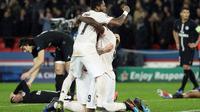 Selebrasi kemenangan pemain Man United pada leg kedua, babak 16 besar Liga Champions yang berlangsung di Stadion Parc des Princes, Paris, Kamis (7/3). Man United menang 3-1 atas PSG. (AFP/ Van Der Hasselt)