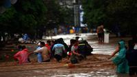 Banjir bandang yang menerjang Sulawesi Utara pada 2014 merenggut nyawa 19 warga dan memorakporandakan ribuan rumah. (Liputan6.com/Yoseph Ikanubun)