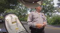 Oknum polisi diduga memeras seorang turis asal Jepang di Bali (Dok.YouTube/Style Kenji)