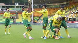 Norwich sempat menggebrak di awal musim dengan fenomena sang striker, Teemu Pukki dan mampu menundukkan juara bertahan, Manchester City. (AP/Catherine Ivill)