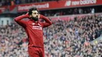 5. Mohamed Salah (Liverpool) - Pemain andalan Timnas Mesir ini berada di urutan kelima, pendapatan penyerang The Reds ini sebesar 37 juta dollar atau Rp 551 miliar. (AP/Rui Vieira)