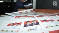 Surat suara Pilpres 2019 terlihat saat pencetakan perdana di PT Aksara Grafika Pratama, Jakarta, Minggu (20/1). KPU memberikan kepercayaan PT Aksara Grafika Pratama untuk mencetak kebutuhan surat suara 72,35 juta lembar. (Merdeka.com/Iqbal S. Nugroho)