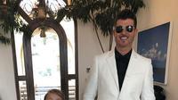 Julian Thicke tampil elegan dalam balutan jas berwarna hitam. (dok. Instagram @robinthicke/https://www.instagram.com/p/BtuHr9Fhuob/Esther Novita Inochi)