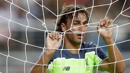 1. Lazar Markovic - Hasil penjualan Luis Suarez digunakan Brendan Rodgers untuk memboyongnya dari Benfica seharga 20 juta poundsterling. Gagal menembus skuat senior, dirinya dipinjamkan ke Hull dan kini ke Anderlecht. (AFP/Lachlan Cunningham)