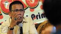 "Politikus PDI Perjuangan Masinton Pasaribu (kiri) berbicara saat diskusi bertajuk ""Benarkah Kabinet Kerja Jokowi-JK Gagal?"" di Jakarta, (24/12). Ia mengungkapkan bahwa Presiden Jokowi berencana merombak kabinet jilid kedua. (Liputan6.com/Helmi Afandi)"
