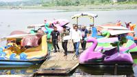 Presiden Jokowi saat melakukan peninjauan ke area wisata situ Bagendit beberapa waktu lalu (Liputan6.com/Jayadi Supriadin)