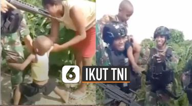 Saat digendong oleh anggota TNI, bocah ini langsung berhenti menangis.