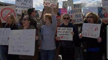 Protes imigran di Carolina, hubungan bilateral Amerika dengan Raja< kebakaran besar di Cile hingga Imlek di Hongkong