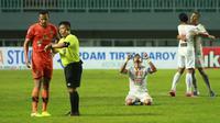 Para pemain Persija Jakarta merayakan kemenangan 1-0 atas Persiraja Banda Aceh dalam laga pekan ke-6 BRI Liga 1 2021/2022 di Stadion Pakansari, Bogor, Sabtu (10/2/2021). (Bola.com/M Iqbal Ichsan)