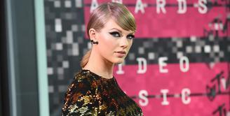 Belum lama ini Taylor Swift mengalami kasus pelecehan seksual yang dilakukan oleh David Mueller. Membawa kejadian ini ke ranah hukum, Taylor pun pada akhirnya memenangkan kasus ini. (AFP/Jason Merritt)