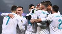 2. Real Madrid - Lolos ke babak perempat final setelah menang agregat 5-2 atas Paris Saint Germain. (AFP/Franck Fife)