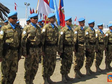 Citizen6, Haiti: Penyematan medali secara serentak selanjutnya diberikan kepada perwakilan para perwira staf, Komandan Peleton dan perwakilan anggota yang disematkan oleh para Komandan Kontingen negara lain.(Pengirim: Badarudin Bakri)