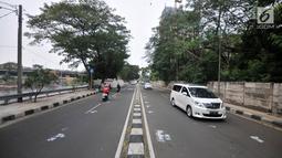 Kendaraan melintas di Jalan Setiabudi Tengah, Jakarta, Minggu (16/6/2019). Rekayasa lalu lintas dari arah Tanah Abang menuju Rasuna Said juga bisa melewati kawasan Landmark-Jalan Sudirman-Jalan Setiabudi Raya-Jalan Setiabudi III. (merdeka.com/Iqbal S. Nugroho)