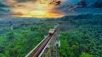 Ilustrasi perlintasan kereta api.