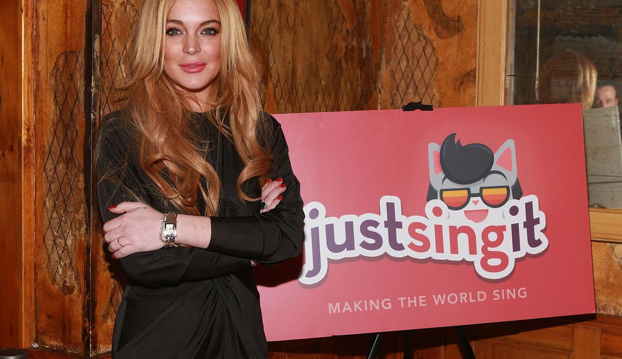 Dunia maya terkadang lebih mengerikan dari dunia nyata, salah bicara sedikit bisa panjang urusannya. Seperti komentar Lindsay Lohan di akun Instagram Ariana Grande, tidak disukai netizen akhirnya banjir di-bully. (AFP/Bintang.com)
