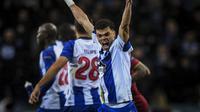 Luapan kegembiraan Pepe pada gol pertaa Porto Florenzi pada leg kedua, babak 16 Liga Champions yang berlangsung di Stadion Do Dragao, Porto, Kamis (7/3). AS Roma kalah 1-3 kontra Porto (AFP/Patricia de Melo)