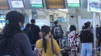 Ilustrasi check-in di bandara (Liputan6.com)